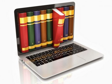 Books popping out of a laptop screen