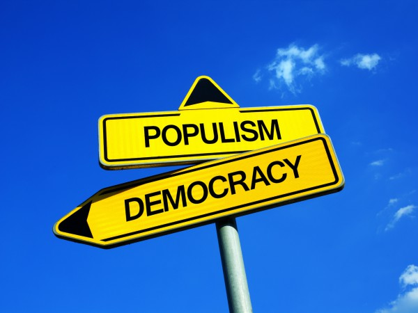 Populism vs Democracy  - Traffic sign with two options - voting for establishment and mainstream democratical party vs electing demagogical populist politicians and politics